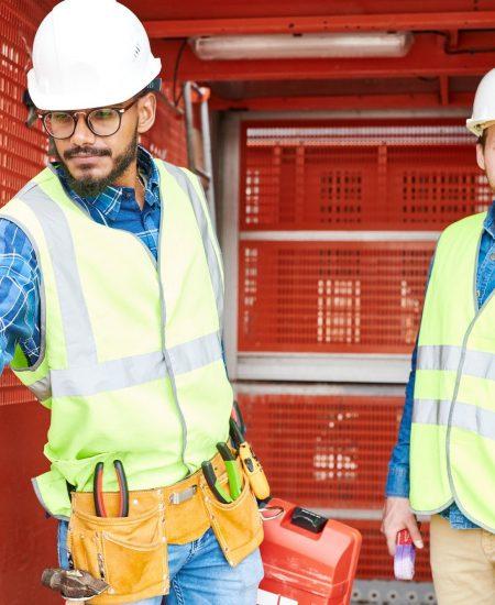 Construction engineers in industrial elevator